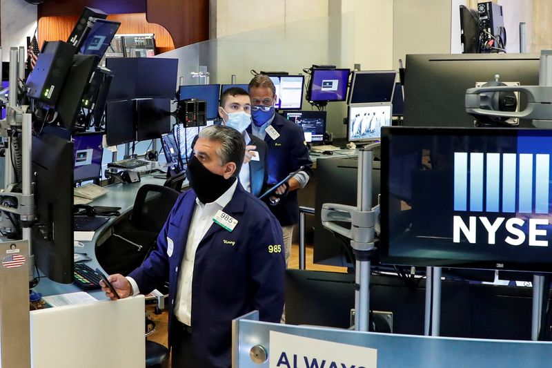 FILE PHOTO: Traders at the New York Stock Exchange during the coronavirus pandemic