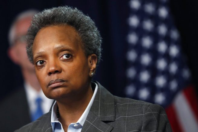 FILE - In this Friday, March 20, 2020, file photo, Chicago Mayor Lori Lightfoot listens to a question after Illinois Gov. J.B. Pritzker announced a shelter-in-place order to combat the spread of the COVID-19 virus, during a news conference in Chicago. A protest and march against Lightfoot is scheduled for Thursday, May 20, 2021. (AP Photo/Charles Rex Arbogast, File)
