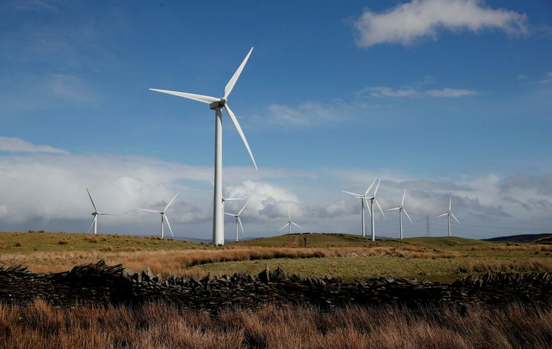 FILE PHOTO: Wind turbines are seen at Mynydd Portref Wind Farm near Hendreforgan in South Wales