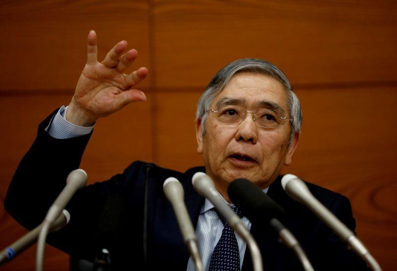 FILE PHOTO: Bank of Japan Governor Haruhiko Kuroda speaks at a news conference in Tokyo