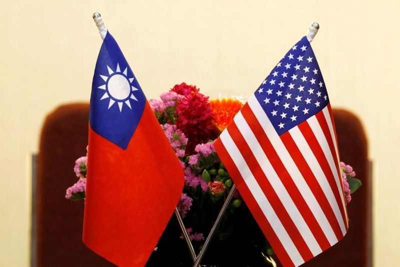 FILE PHOTO: Flags of Taiwan and U.S. are placed for a meeting in Taipei