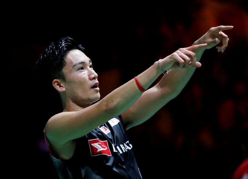 FILE PHOTO: Japan's Kento Momota celebrates winning men's singles final at 2019 Badminton World Championships