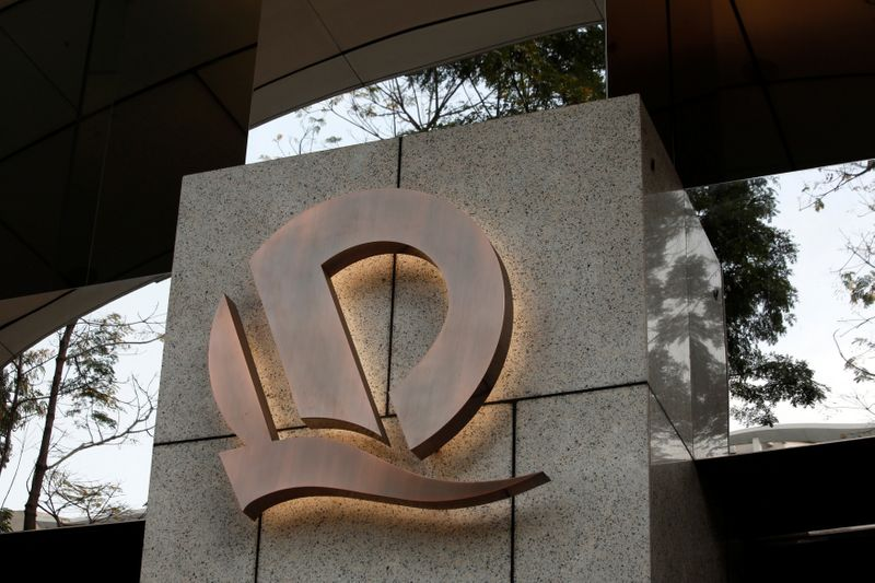 A company logo of China Evergrande is displayed at the entrance to China Evergrande Centre in Hong Kong