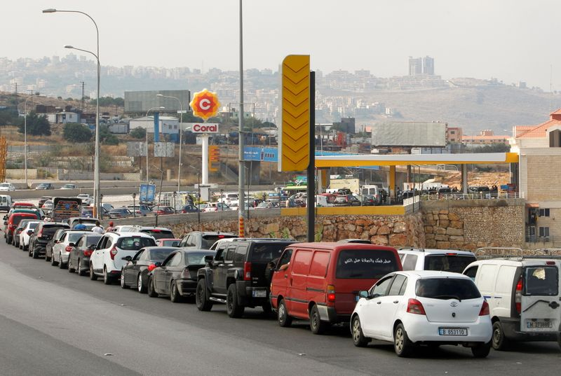 FILE PHOTO: Cars stand in line at a gas station as they wait to fuel up in Damour