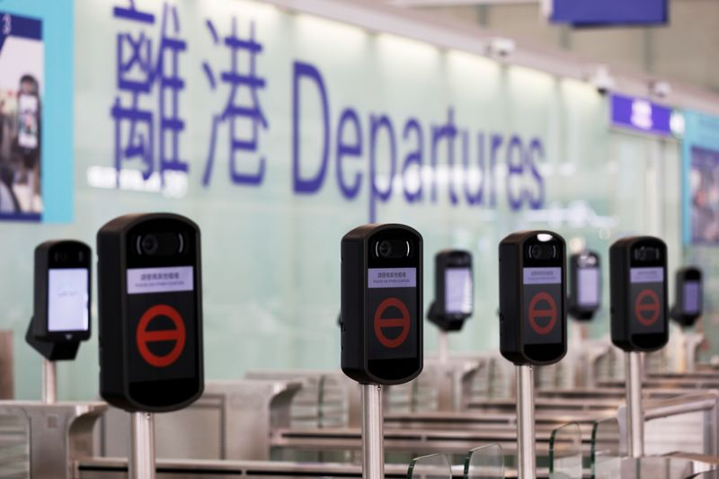 FILE PHOTO: Closed counters are seen at the departures hall of Hong Kong International Airport, following the coronavirus disease (COVID-19) outbreak, in Hong Kong, China