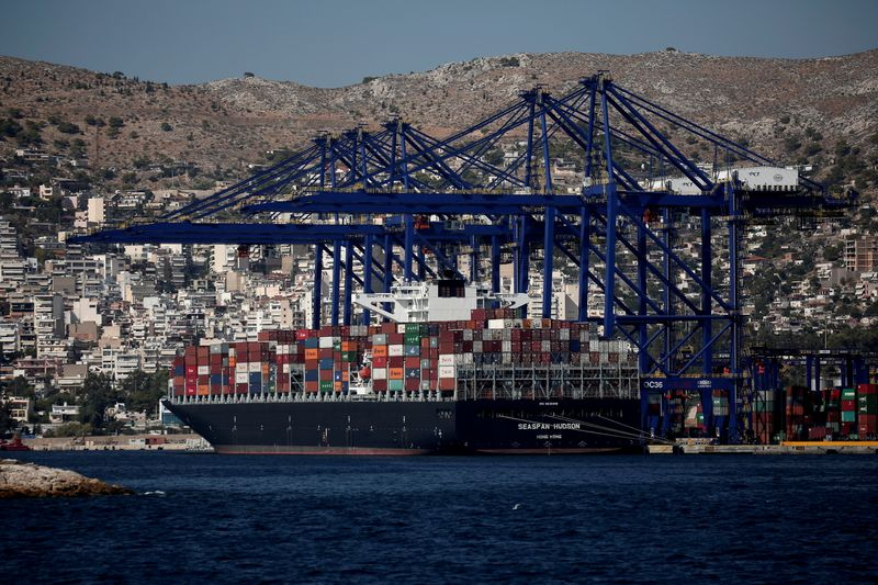 FILE PHOTO: FILE PHOTO: A cargo ship is moored at the Piraeus Container Terminal, near Athens