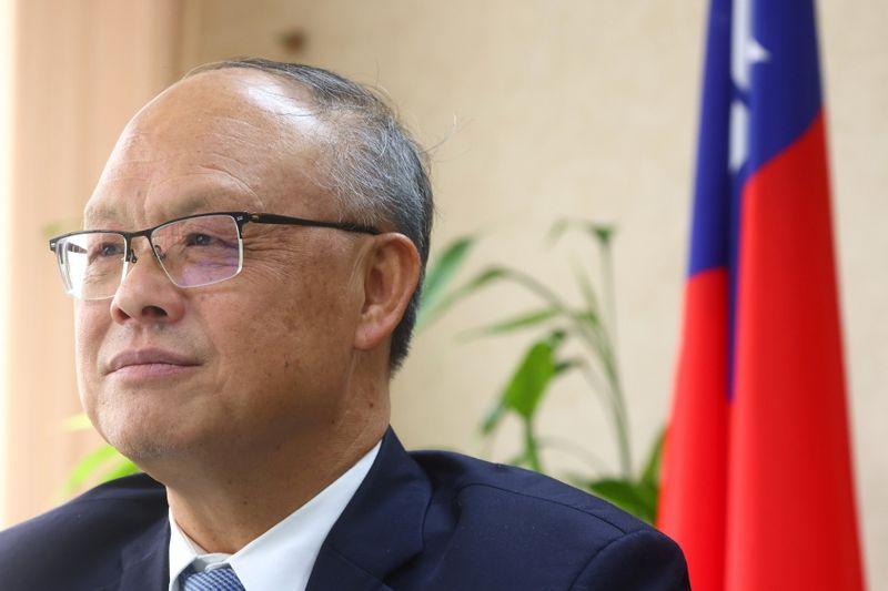 Taiwan's Chief trade negotiator John Deng looks on as he speaks to the media in Taipei