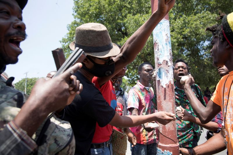FILE PHOTO: People make noise during a protest against an epidemic of kidnappings sweeping Haiti, in Port-au-Prince