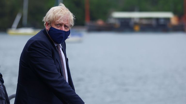 Prime Minister Boris Johnson arrives by boat for a visit to the workshop of Scott Woyka Furniture in Falmouth, ahead of the G7 summit in Cornwall. Picture date: Thursday June 10, 2021.