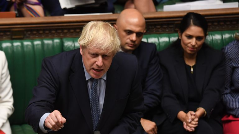 Boris Johnson is pictured alongside Mr Javid in the Commons in 2019