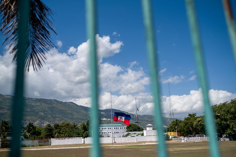 FILE PHOTO: The Haitian national flag waves at half-mast where the Haitian Presidential Palace used to be, in Port-au-Prince