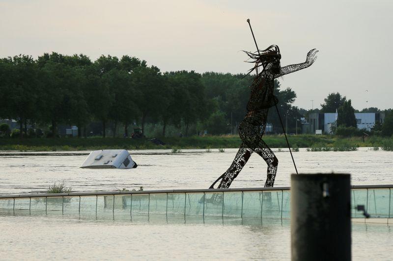 FILE PHOTO: A caravan floats down the river Meuse, in Venlo