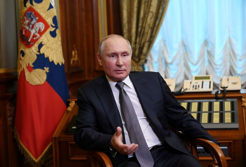 FILE PHOTO: Russian President Putin answers questions about his article