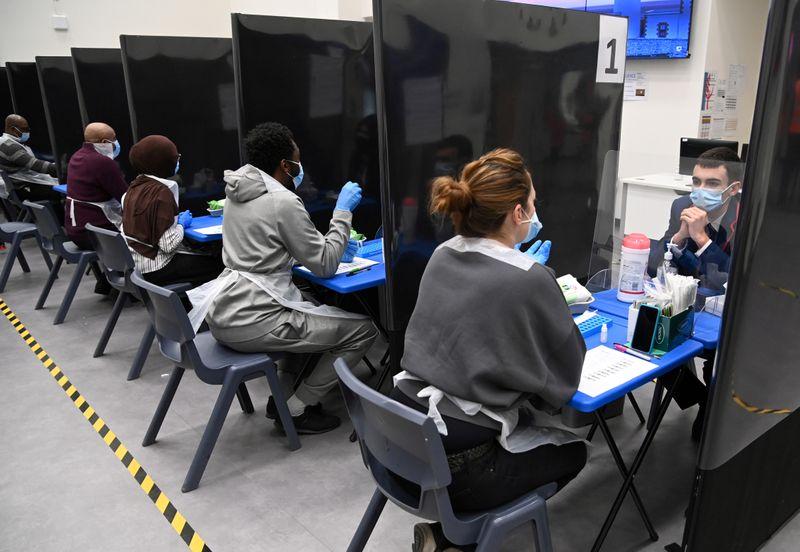 FILE PHOTO: Students take coronavirus disease (COVID-19) tests at Harris Academy Beckenham, in  London