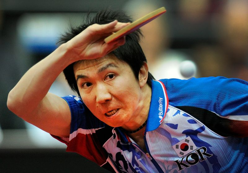 Ryu of South Korea plays against Wang of China during their World Table Tennis Championships in Rotterdam