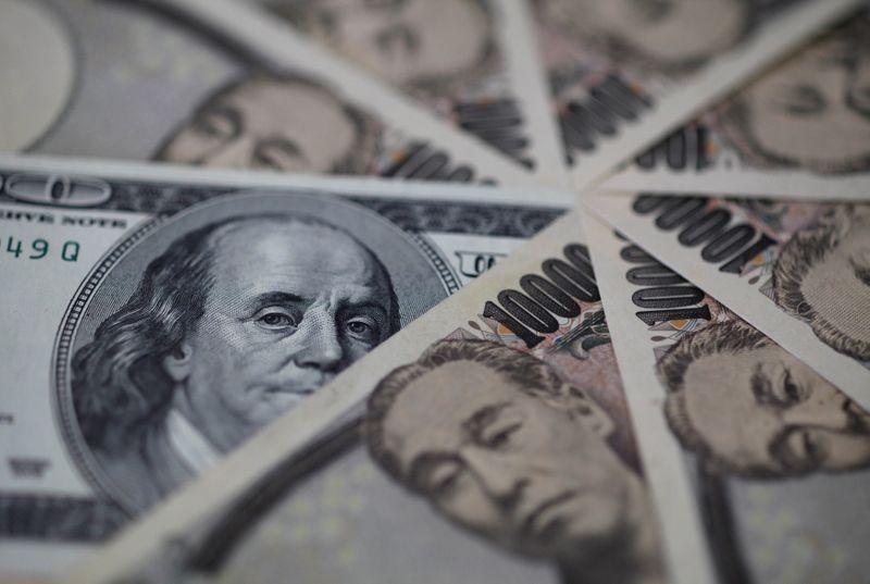 FILE PHOTO: Illustration photo of U.S. dollar and Japan yen notes