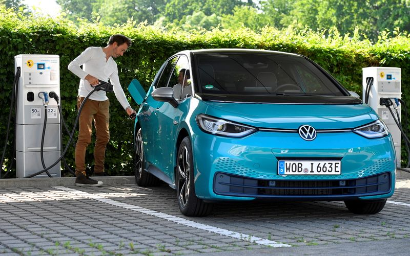 FILE PHOTO: A man charges an electric Volkswagen ID.3 car