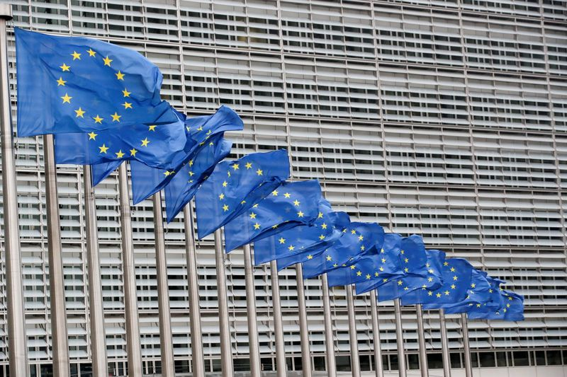 FILE PHOTO: Flags flutter outside EU Commission in Brussels