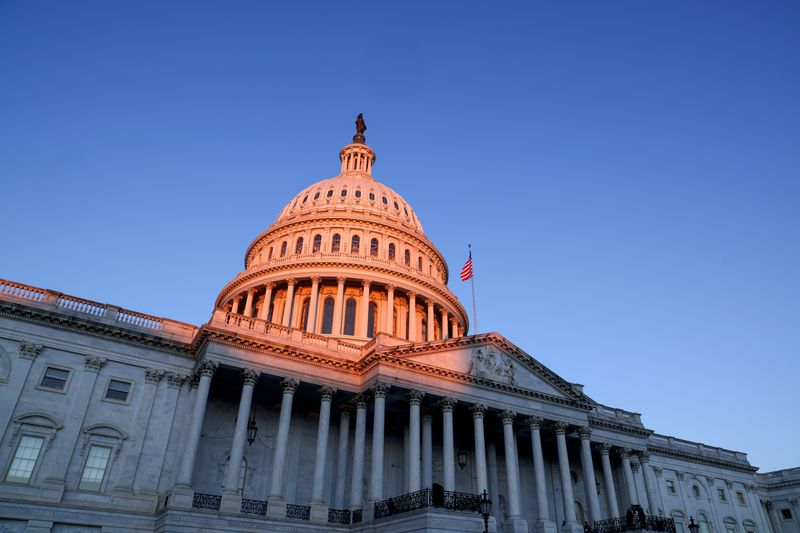 FILE PHOTO: The sun rises on the U.S. Capitol dome before Joe Biden's presidential inauguration in Washington