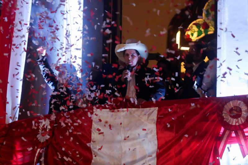 FILE PHOTO: Leftist Pedro Castillo celebrates after Peru's electoral authority announced him as the winner of the presidential election, in Lima