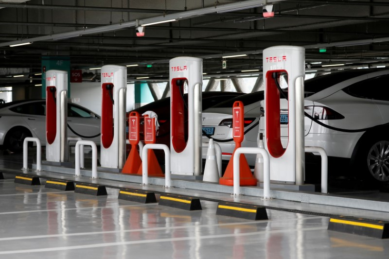 FILE PHOTO: Tesla electric vehicles are charged at a Tesla Supercharger charging station in Hanam