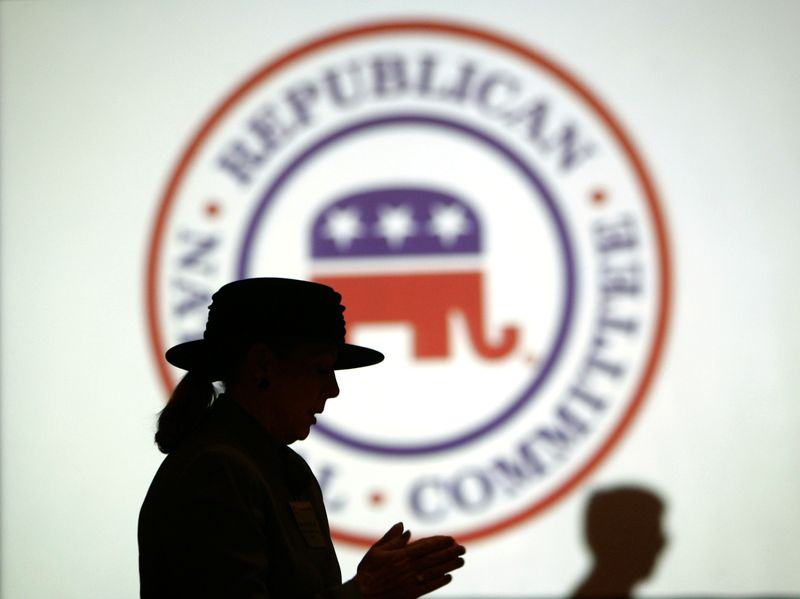 FILE PHOTO: Republican Party members are silhouetted against RNC logo during a meeting in Washington