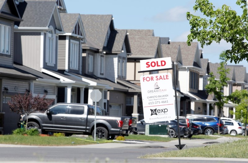 FILE PHOTO: A realtor's 'sold' sign stands outside a house in Ottawa, Ontario, Canada