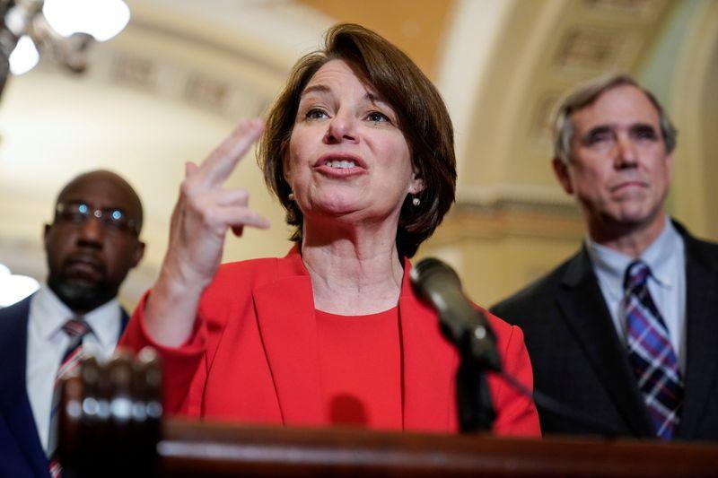 FILE PHOTO: Senator Amy Klobuchar (D-MN) speaks to the media in Washington
