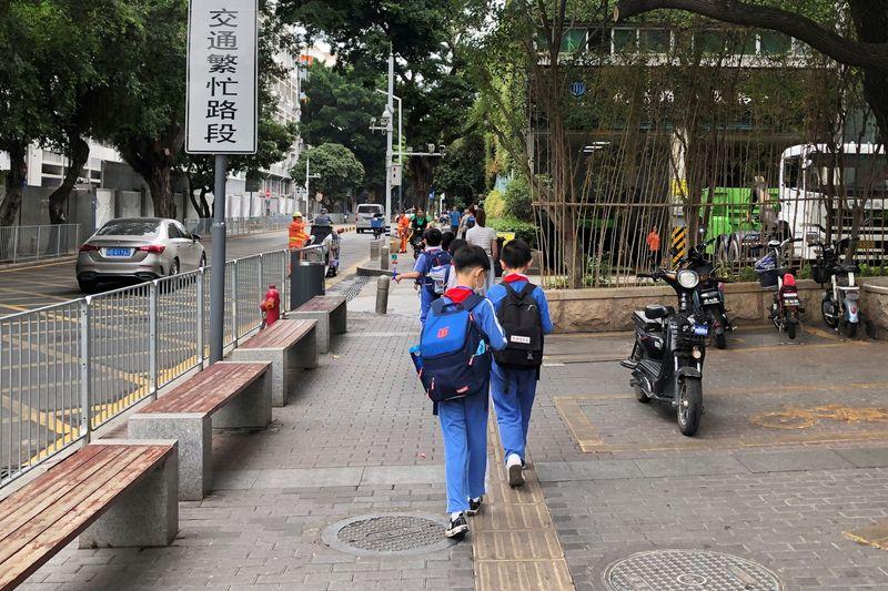FILE PHOTO: Children leave a school in Shekou area of Shenzhen