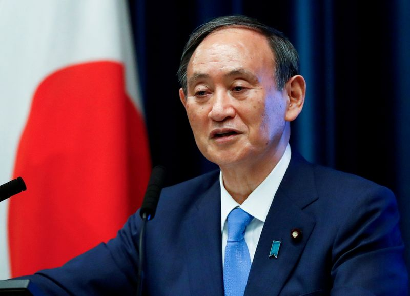 FILE PHOTO: Japan's Prime Minister Yoshihide Suga attends a news conference on Japan's response to the coronavirus disease (COVID-19) outbreak, in Tokyo