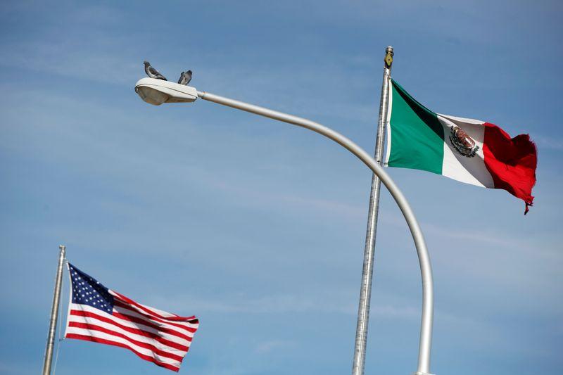 The US flag and the Mexico's flag are pictured on the international border bridge Paso del Norte in between El Paso US and Ciudad Juarez in Ciudad Juarez, Mexico