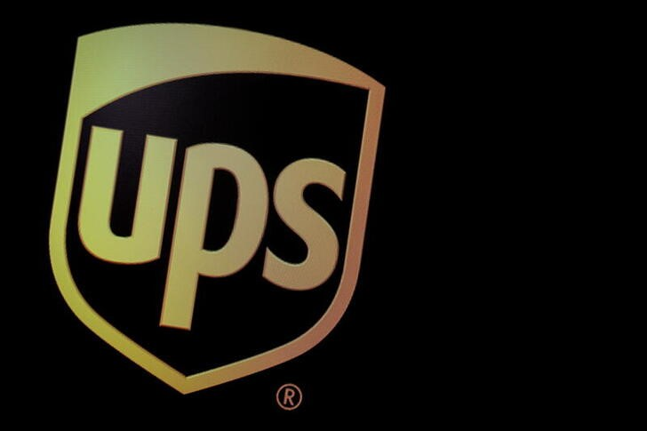 FILE PHOTO: FILE PHOTO: The company logo for United Parcel Service (UPS), is displayed  on a screen at the NYSE in New York