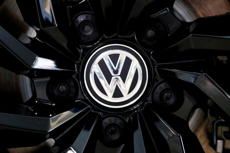 FILE PHOTO: The logo of German carmaker Volkswagen is seen on a rim cap in a showroom of a Volkswagen car dealer in Brussels