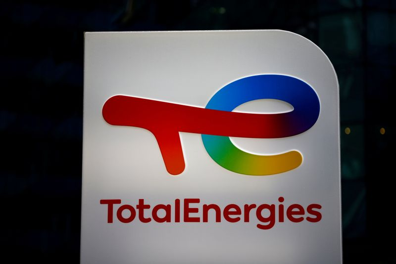 FILE PHOTO: The logo of French oil and gas company TotalEnergies is pictured at an electric car charging station in Courbevoie