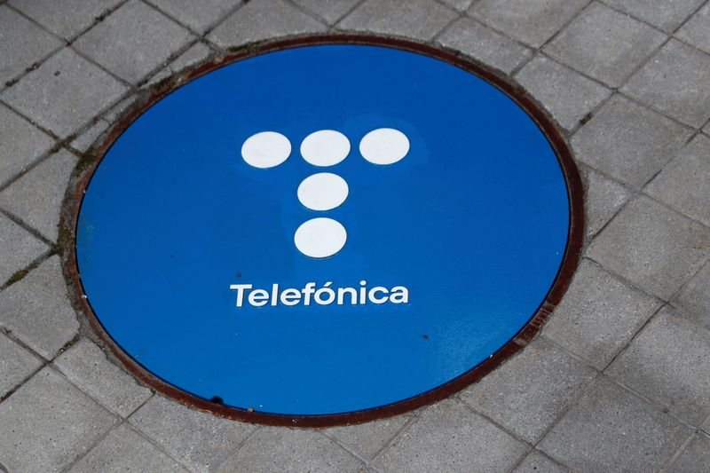 The logo of Spanish Telecom company Telefonica is seen on a sewage cover outside in Madrid