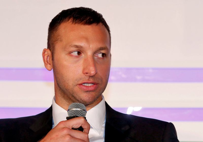 Australian swimmer Ian Thorpe attends a news conference in Mumbai