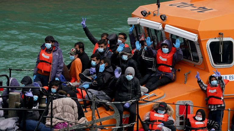 A group of people thought to be migrants are brought in to Dover, Kent, onboard a lifeboat following a small boat incident in the Channel earlier on Sunday. Picture date: Sunday July 4, 2021.