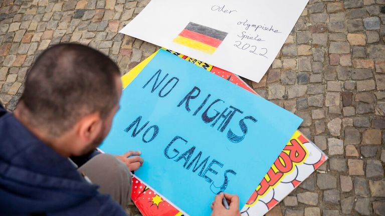 A protestor at the Brandenburg Gate in Berlin during demonstrations in June this year