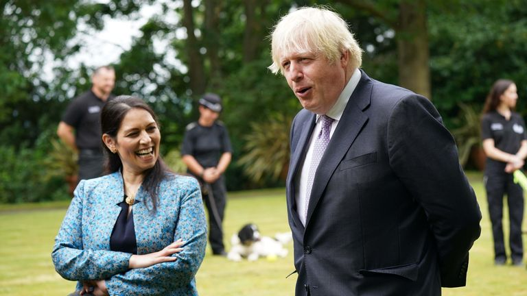 Prime Minister Boris Johnson and Home Secretary Priti Patel during a visit to Surrey Police headquarters in Guildford, Surrey