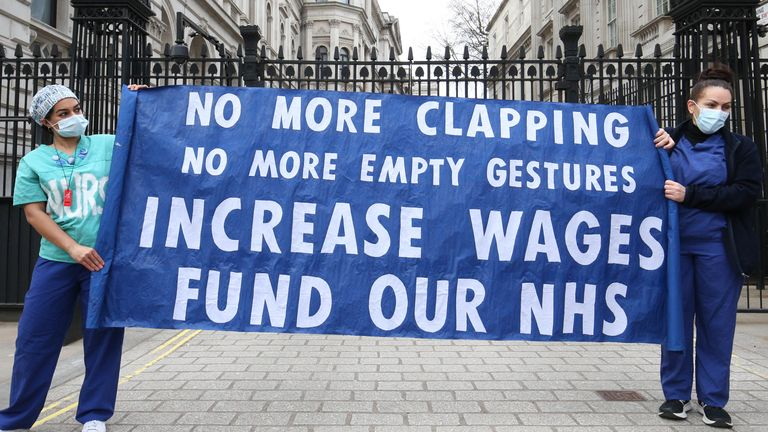 Nurses and NHS workers from the campaign group NHS Workers Say No, and Unite's Guys and St Thomas Hospital Union branch, hold a socially distanced protest outside Downing Street in London over the proposed 1% pay rise from the Government